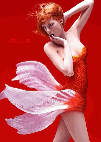 Анимация Девушка на красном фоне, в образе Золотой рыбки, с развивающимися волосами и низом платья