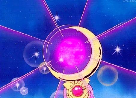 Анимация Сверкающие блики с лилового шара, находящегося внутри полумесяца, являющегося частью броши