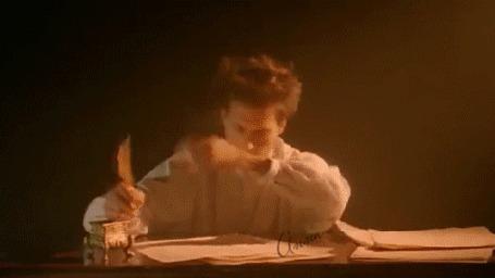 Анимация Мужчина что то пишет за письменным столом, проваливается в сон и резко просыпаясь оглядывается (кадр из ролика Энигма)