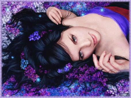 Анимация Девушка брюнетка лежит на цветах сирени, распустив волосы
