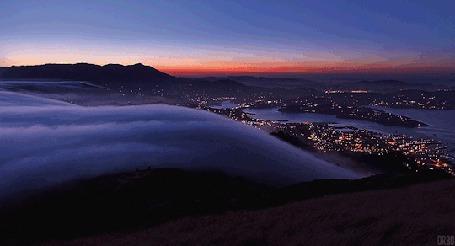 Анимация Проплывающие облака в горах, внизу виднеется город, by Orbo (© Seona), добавлено: 22.04.2015 12:14