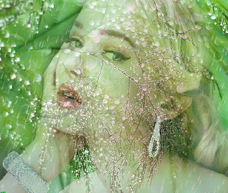 Анимация Лицо зеленоглазой девушки с украшениями в ушах и на руке под каплями дождя, на фоне зеленой листвы и цветущего дерева