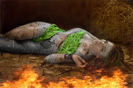 Анимация Полуобнаженная девушка лежит на растрескавшейся земле, по ней стекают капли, рядом стелется пламень (© Bezchyfstv), добавлено: 17.05.2015 19:32