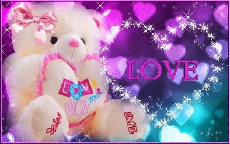 Анимация Белый мишка с сердечком на цветном фоне сердечек (love) zanoza