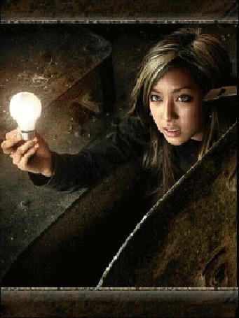 Анимация Девушка азиатской внешности держит в руке зажженную лампочку (© Akela), добавлено: 02.06.2015 18:58