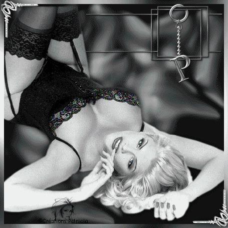 Анимация Красивая блондинка в черном нижнем белье лежит на темно-сером фоне / greations Patricia/ (© qalina), добавлено: 13.06.2015 13:07