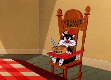 Анимация Кот Sylvester сидит на стуле с тарелкой (© zmeiy), добавлено: 13.06.2015 18:48