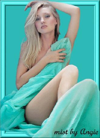 Анимация Красивая девушка блондинка с голубыми глазами прикрывается бирюзовой шелковой тканью / mist ly Angie/ (© qalina), добавлено: 22.06.2015 17:28