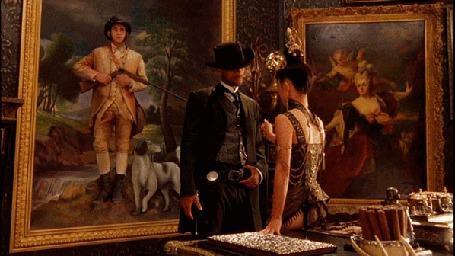 Анимация Мужчина с женщиной разговаривают, а из картины в них метится охотник из ружья