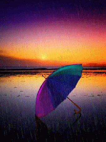 Анимация Зонтик под дождем на морском берегу