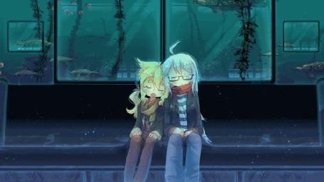 Анимация Две девушки спят в океанариуме