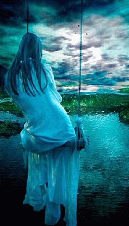 Анимация Девушка качается на качелях у озера