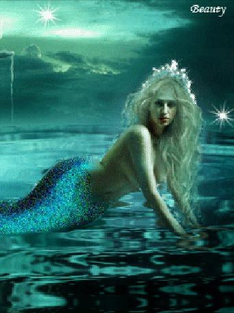 Анимация Красивая русалка с короной на голове на фоне мелькающих звезд, Beauty