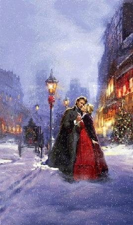 Анимация Влюбленные в метель стоят, обнимаясь на заснеженной улице города у светящего фонаря, на фоне домов и сверкающей гирляндами новогодней елки