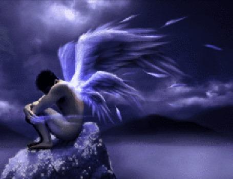 Анимация Ангельский парень грустит на камне