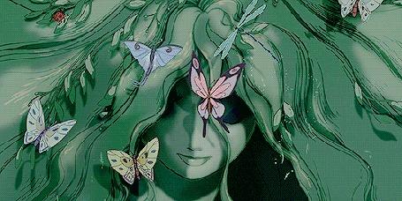 Анимация Порхающие разноцветные бабочки на волосах девушки