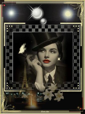 Анимация Девушка в черной шляпе и сигарой в руке мечтает о Париже