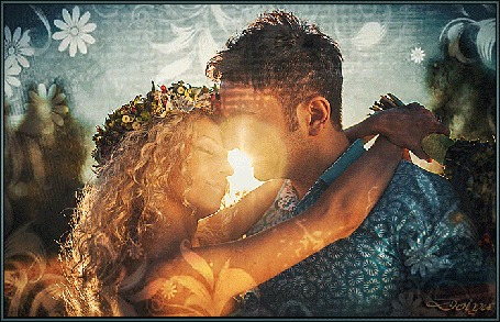 Анимация В лучах солнца стоят, обнявшись, мужчина и девушка