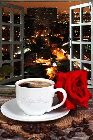 Анимация Чашка кофе с розой перед окном с видом на ночной город (Eclipse moon)