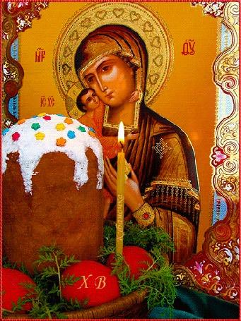 Анимация Перед иконой Богородицы пасхальный кулич, горящая свеча, корзина с раскрашенными яйцами