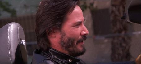 Анимация Актер Киану Ривз / Keanu Reeves подмигивает одним глазом