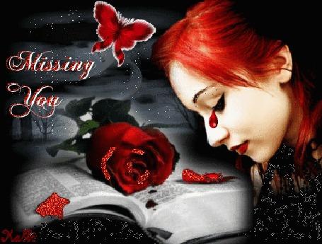 Анимация Девушка с красными волосами, красная слеза. На открытой книге лежит красная роза, сверху красная бабочка и надпись-MISSING YOU