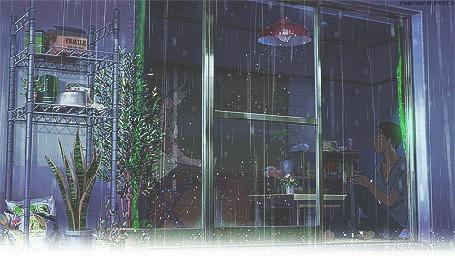 Анимация Парень сидит за окном, на улице идет дождь, аниме Сад Изящных Слов