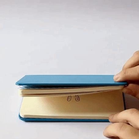 Анимация Руки человека открывают блокнот, на листке которого нарисован мальчик
