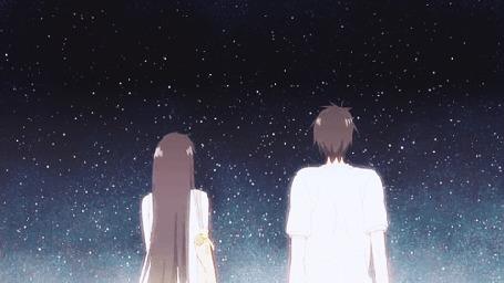 Анимация Парень с девушкой стоят перед звездным небом