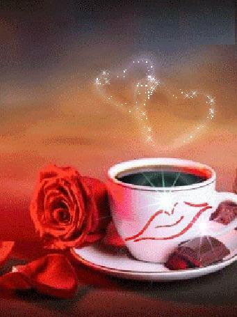Анимация На чашке с кофе губы изображают поцелуй, рядом на блюдце лежит красная роза и кусочек шоколада, над чашкой парят два сердечка