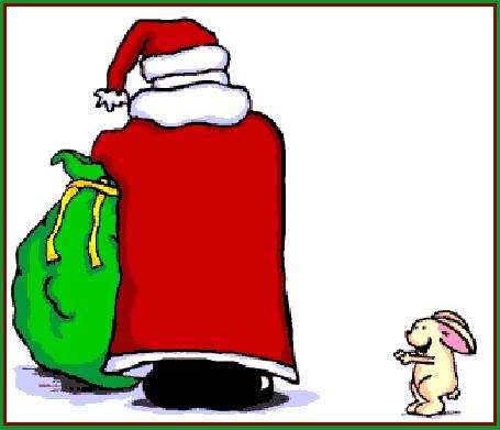 Анимация Дед мороз достает подарок из мешка и отдает зайцу