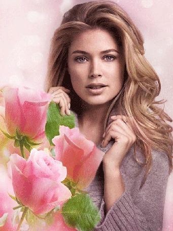 Анимация Самая красивая блондинка Doutzen Kroes Pose с букетом роз на фоне световых бликов
