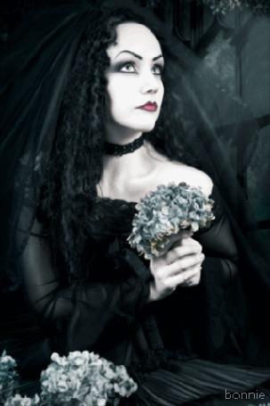 Анимация Девушка- готесса в черной одежде с цветами в руках, by bonnie