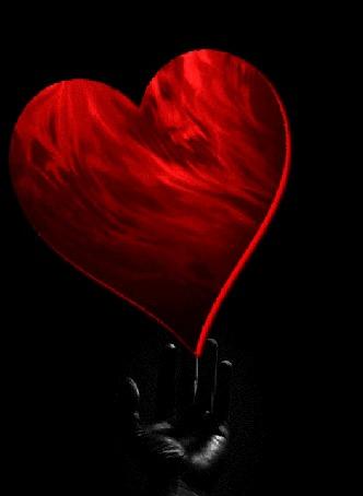Анимация Над рукой человека красное сердечко