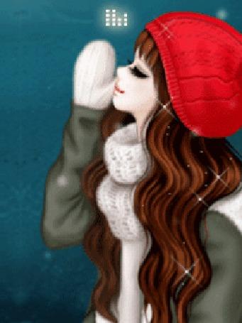 Анимация Девушка в зимней одежде под падающим снегом, приложила руку в белой варежке ко рту