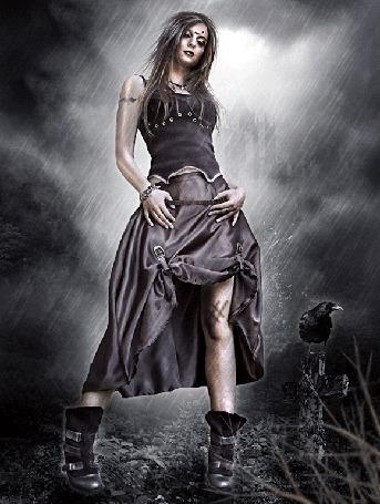 Анимация Девушка с татуировкой на руке стоит под дождем у креста на могиле, на котором сидит ворон, by NatsPearlCreation