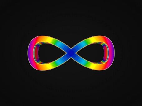 Анимация Объемный знак бесконечности, переливающийся всеми цветами радуги, вращается на черном фоне