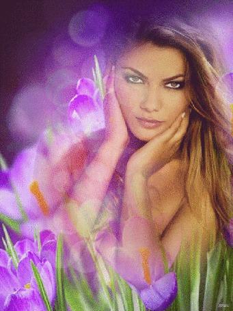 Анимация Красивая девушка на фоне весенних цветов и бликов боке