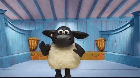 Анимация Черная овечка в белой шубке, стоя на голубой стене, весело танцует, хлопает передними копытами и поет Аллилуйя