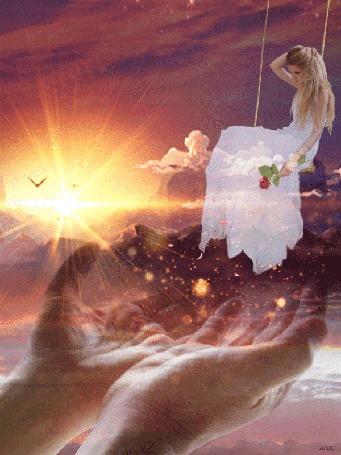 Анимация Ладони мужчины тянутся к девушке на качелях, у нее в руке роза, с которой падают лепестки, на фоне фантастического заката солнца, с ладоней к ней летят солнечные блики в виде боке