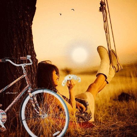 Анимация Девушка с ромашками в руке сидит у дерева