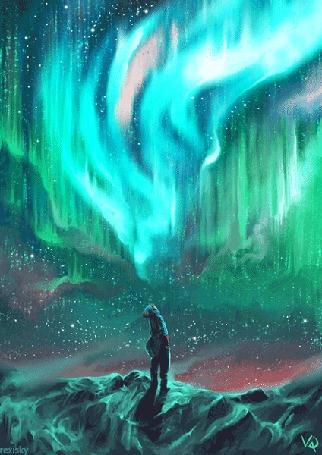 Анимация Парень стоит на фоне северного сияния