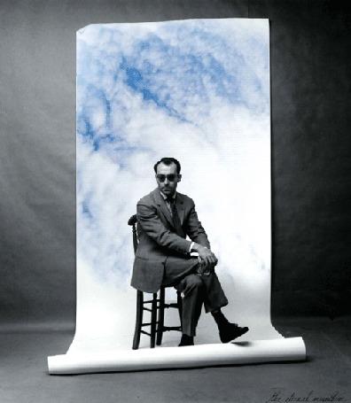 Анимация Мужчина сидит на стуле на фоне огромного листа бумаги с плывущими облаками