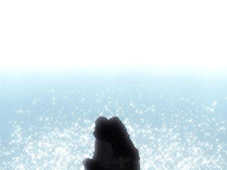 Анимация Влюбленные сидят у сияющего моря