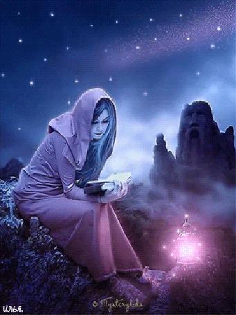Анимация Девушка сидит на скале под звездным небом и читает книгу