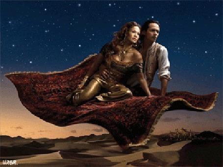 Анимация Молодая пара под звездным небом летит на ковре-самолете через пустыню