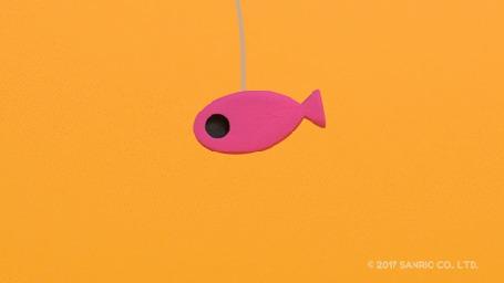 Анимация Черный котенок пытается достать розовую рыбку, привязанную к веревочке
