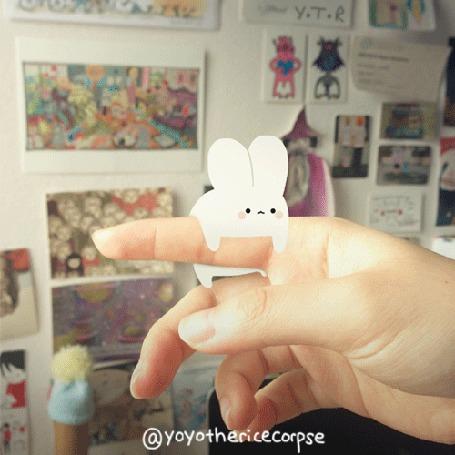Анимация На пальце руки человека белый зайчик, by yoyothericecorpse