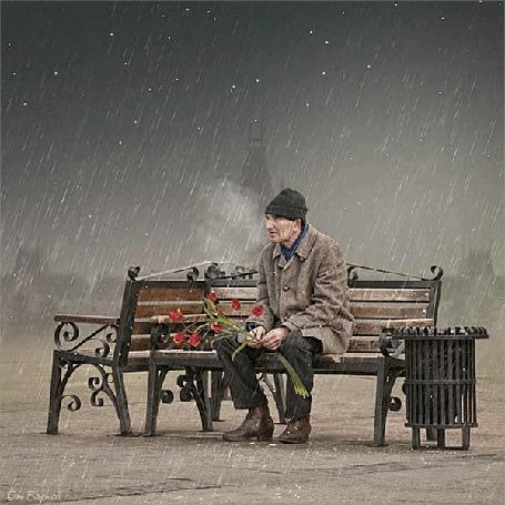Анимация Мужчина с развевающимся букетом тюльпанов сидит под дождем и снегом, by Ionut Caras