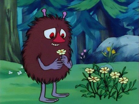 Анимация Смешной лесной чудик украсил себя ромашкой